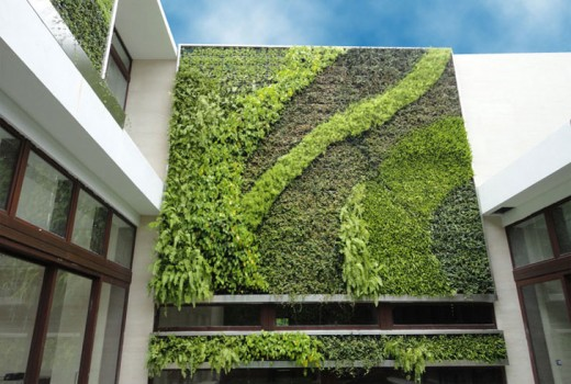 A vertical garden on the outside of a building